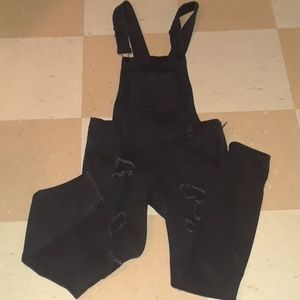 Distressed skinny overalls